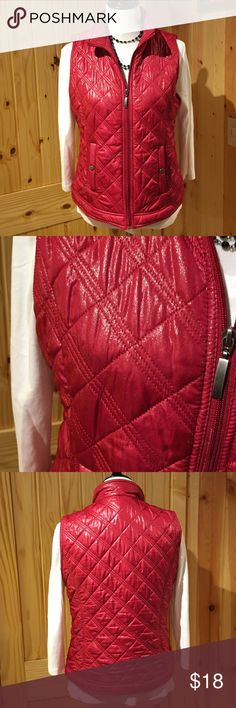 "Chico's metallic red holiday vest! Sz 1 EUC ❤️❤️ Chico's size 1, 8–10, red vest with a silver metallic type accent! It's absolutely gorgeous!  It has two pockets in the front with snap closures it is approximately 1 1/2 inch band at the bottom. It is quilted w/diamond pattern with double threads, very detailed. It is 22 1/2"" from neck to bottom not including the collar. 19 1/2""  armpit to armpit. It is 100% polyester fill 100% polyester lining and 100% polyester. Chico's Jackets & Coats…"