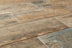 Wood tile flooring that looks like actual wood planks. Find tips on choosing the best wood tile options at www.AimeChristineInteriors.com