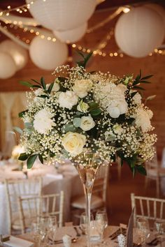 Flowers Arrangement Tall Table Foliage Ribbon Rose Fresia Gypsophila Greenery White Contemporary Wedding Styal Lodge Cheshire http://hayleybaxterphotography.com/ #flowers #centrepiece #tall #arrangement #Foliage #Ribbon #Rose #Fresia #Gypsophila #Greenery #wedding #weddingflowers
