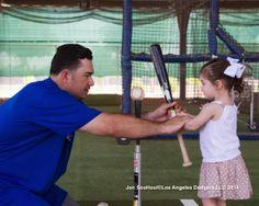 Adrian coaching his daughter, pic via Jon SooHoo/LA Dodgers 2014