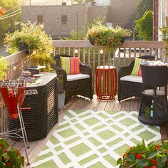 A high-style synthetic area rug is the ideal way to expand a small space: http://www.bhg.com/home-improvement/deck/ideas/small-deck-decorating/?socsrc=bhgpin042614addflairunderfoot&page=12