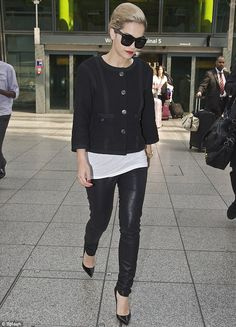 She's home! Rita Ora lands in London rocking tight leather leggings and shades   Mail Online