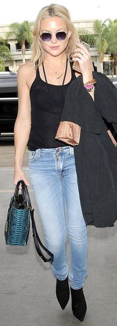 Who made  Kate Hudson's silver sunglasses, skinny jeans, and blue python print handbag?