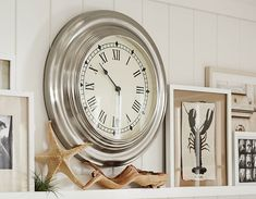 Like the clock. Also checking out how they decorate the mantel.   Coastal Style Ideas | Pottery Barn