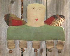 """""""Penelope Grace,"""" a primitive angel doll handmade by Prairie Primitives and available on Etsy."""