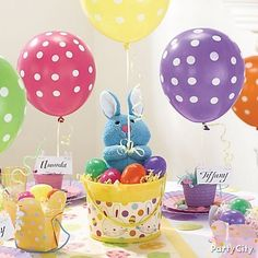 Fill the room with floating Easter eggs using pretty pastel polka-dot balloons! Click for lots more Easter decorating & tablescape ideas.