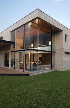 Vista doble altura living: Casas de estilo moderno por JV&ARQS Asociados