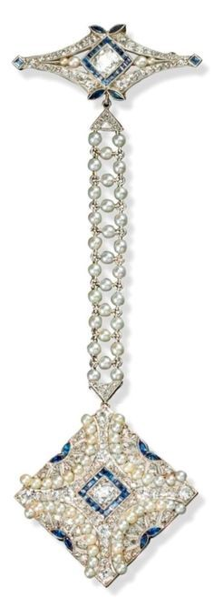 A Belle Epoque sapphire and diamond fob brooch. The quatrefoil plaque with carved and pierced demi-lunes pave-set with circular-cut diamonds and calibré and marquise-shaped sapphires with semi circular lines of seed pearls and suspending from a seed pearl mounted chain and a diamond, sapphire and seed pearl brooch in platinum. 11cm long. #BelleÉpoque #brooch
