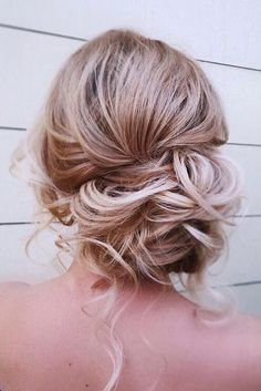 23 a messy curly low side bun with some curls down is a great idea for an effortlessly chic look - Weddingomania
