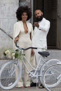 Happy day: Solange posed for a snap outside the venue, giving a huge grin for the camera with Alan