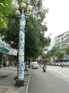 In preparation for the Beijing China 2008 Olympics porcelain Jingdezhen tubes were created to cover the lamp posts.  Lamposts like the one shown here lined the streeets.
