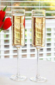 Cheers to the new Mr. and Mrs. with these romantic champagne flutes!