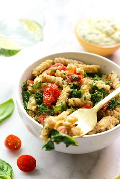 Looking to mix up your pasta dish? Make this delicious Creamy Vegan Pasta with Sautéed Kale, and Tomatoes.