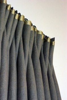 old gold trim detail on grey tweed curtains