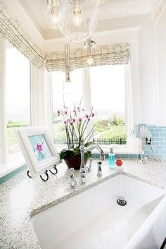 """normally I don't like a kitchen sink """"corner"""" but this one is so delightful... made so by the wonderful full windows. sigh! i think i could clean up a major bunch of dishes standing here."""