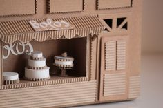 Close up of cardboard bakery by Oupas! Design