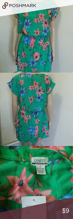Floral light weight dress NWT Size small light weight floral summer dress with elastic waist. New with tags. Dresses