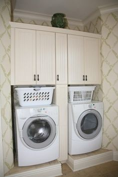 Leaving enough room for the laundry basket between the machines and the cabinets -- Laundry Storage - traditional - laundry room - cleveland - Schill Architecture LLC
