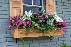 Like the raised panel shutters with matching window box. Classy.