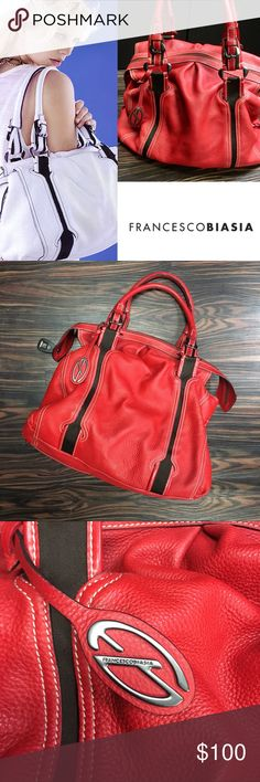 """FRANCESCO BIASIA Adah Satchel Francesco Biasia satchel is red italian leather. It is large enough to carry all of your essentials. Top zipper closure. The bag's measurements are approx. 12"""" Height, 15"""" Length, 5"""" Width. The hardware detailing is dark silver tone. Pebble-grain genuine leather body. Interior is split into 2 compartments with zip pouch in dividing wall. Multi-color fabric fully lines these purses inside. A zipper pocket, an open pocket and a cell phone holder are on the inside…"""