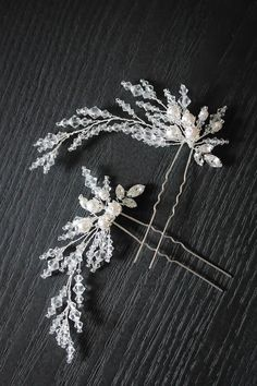 A beautiful set of 2 detailed bridal hair pins, lovingly handcrafted from shimmering crystals and pearls in a unique flared silhouette.