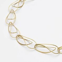 Kathrin Satelle simple and delicate folded gold wire for necklace....http://www.pinterest.com/renukostyle/metal/