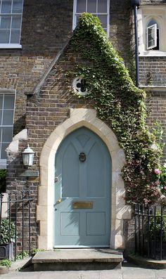 Gothic arch door with quatrefoil window above. & blue door overhead plaque~House of History LLC.   Harvard ...