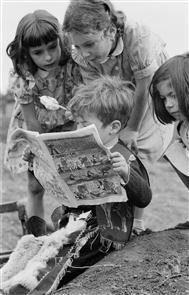 Children reading a comic book, Lollard Adventure Playground, Lambeth, London, 1955