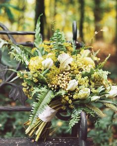 Floral designer Amy Merrick let seasonal foliage, including Boston ferns and wild grasses, take center stage in this bouquet for Chelsa and Dennis's October wedding in upstate New York.