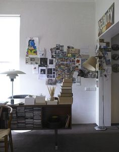 the 'end-of-the-world' wall in his bedroom is covered with pictures and things