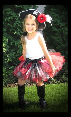 pirate princess? red & black tutu could be reused for Tech attire. :)