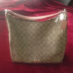 Coach shoulder bag Brown insignia medium sized bag in great condition. Inside has a zipper pouch and two side pockets for phone or keys. Very faint signs of wear on the bottom corners. Price is firm. Coach Bags Shoulder Bags