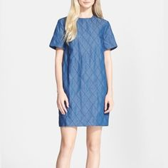 kate spade new york Quilted Chambray Dress Short sleeve shirt dress with quilted chambray fabric- dark blue color. 14k played zipper with bow detail in back. Cotton lined. Crew neckline. Shell: 63% cotton, 37% lyocell. Lining: 100% cotton. kate spade Dresses Mini