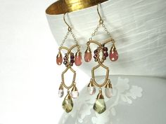 Red raspberries stain your lips, as you sip golden sparkling Champagne from a flute. These luxurious yet playful earrings sparkle in the light,