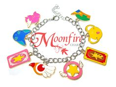 This bracelet is a tribute to the Cardcaptor Sakura fandom! Great for any CS fan! The enamel and silver-plated bracelet measures 7 inches. It comes with a lobster hook and clasp.