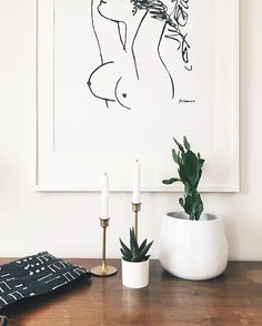 I've been staring at these breasts for days. I love my office but it's currently a disaster, filled with piles of paper and props & items to be donated. I can't be productive in a cluttered space so I've been working in my dining room where I can be inspired by Picasso 😛 P.S. I can't believe these plants survived my black thumbs. Gotta love low maintenance plants! 🌵🌿 . . . #currenthomeview #torontodesigner #interiorstyling #cdnblogger #torontoblogger #workfromhome #workfromwherever…