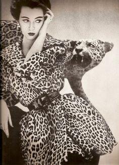 Richard Avedon, Dovima wearing a Leopard fur coat by Bernham-Stein, 1950