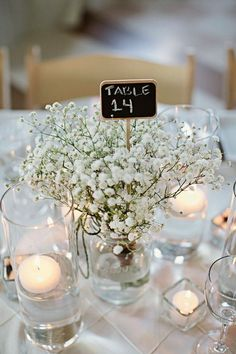 rustic white baby's breath wedding centerpiece / http://www.himisspuff.com/rustic-babys-breath-wedding-ideas/14/