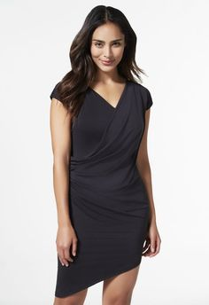 Go for something a little sultry with this drapey knit dress. A surplice neck with side draped detailing, it's the perfect silhouette to go out in and make those heads turn. Asymmetrical hem....