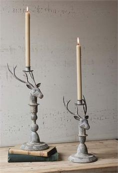"This holiday season, give your farmhouse a country cabin feel with our Rustic Metal Deer Candle Holders. These graceful deer heads with antlers feature a weathered zinc patina and hold taper candles for added elegance. Set of two: Large, 5.5""W x 16""H, Small, 5.5""W x 12""H"