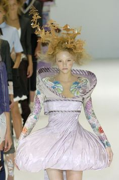 Alexander McQueen 2005.  I'm amazed I didn't see this headpiece on a guest at the royal wedding.