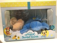 Disney Park Magical Slumber Sounds Sleeping Musical Baby Mickey Mouse Plush Doll. Exclusive item from Walt Disney World theme parks and resorts!. Mickey plush doll is both soft and cuddly and helps your child go to sleep. Push Mickey's foot to start one of 4 soothing lullabies. Approx 12 inches by 7 inches by 6 inches in size. Operates via 2 AA batteries which are safely hidden inside. Batteries are easily replaceable. Battieries are included but have been used for display and may be low....