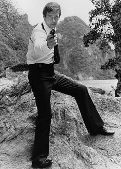 Roger Moore as James Bond Roger Moore, Spy Who Loved Me, James Bond, Persona, The Man, Celebrities, 1970s, Gun, Names