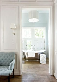 Where to begin? Love the wall color in the bathroom, sconce, molding...