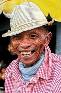 Malagasy Smile.  A friendly Malagasy man shares a smile with a stranger. As I returned the gesture we are no longer stingers, but friends.  By James Bokovoy