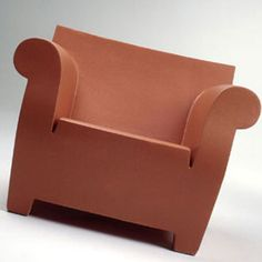 Nice take on a traditional Chesterfield armchair made in plastic, probably Polypropylene, using Rotational Moulding.