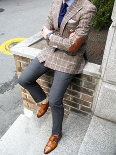 Shop this look on Lookastic: http://lookastic.com/men/looks/double-monks-dress-pants-dress-shirt-blazer-tie-pocket-square/1524 — Tan Leather Double Monks — Grey Dress Pants — Light Blue Dress Shirt — Brown Plaid Blazer — Navy Tie — White Pocket Square