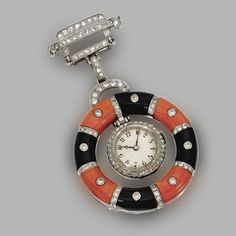 ART DECO Platinum, Coral, Onyx, and Diamond Pendant-Watch, circa 1925.