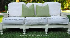 Turn those old vintage sofas into cute cottage style pieces! Old chunky 70's sofa. Just painted white and covered the wagon wheel cushions with drop cloth!