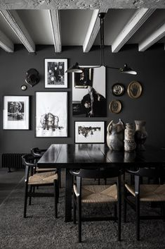 Maison Hand - dark - desire to inspire - dark walls + black square table + serge mouille + gallery wall